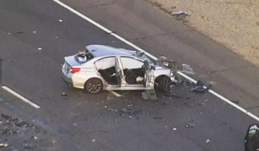 This photo taken from video provided by KPHO/KTVK shows the scene of a fiery wrong-way, head-on collision, Tuesday, Nov. 1, 2016 in Phoenix.  Authorities say the wrong-way vehicle was eastbound on westbound Loop 101 when the collision occurred, closing that portion of the freeway and diverting traffic onto Interstate 17.(KPHO/KTVK via AP)