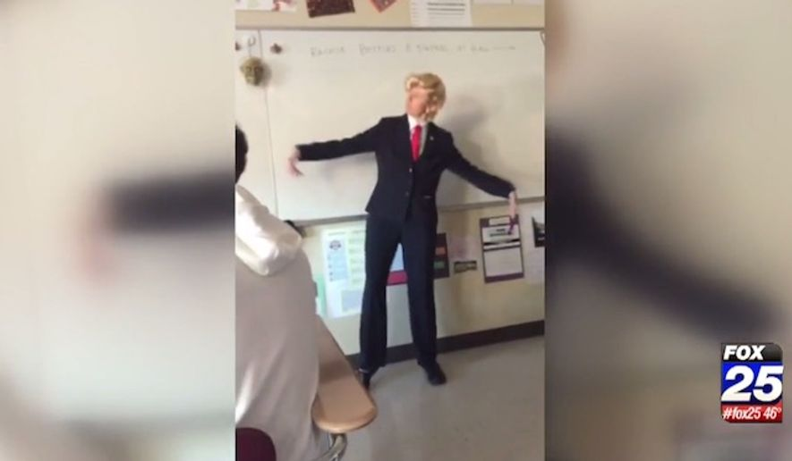 "Kara Kelley, a geometry teacher at Portsmouth High School, has been removed from the classroom after she was seen in a video dancing to the song, ""*&%$ Donald Trump,"" while dressed as the Republican presidential nominee. (WFXT)"
