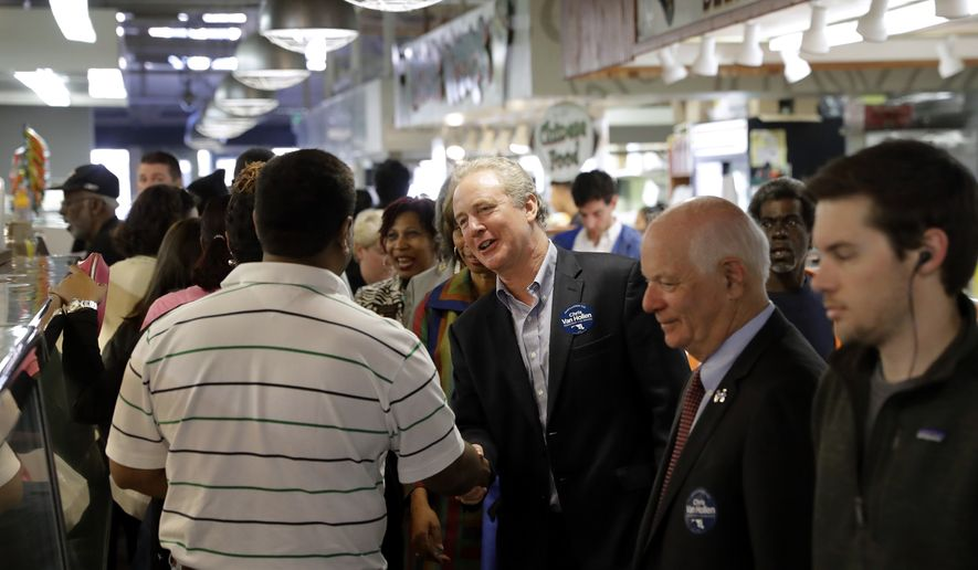 Rep. Chris Van Hollen, D-Md., center greets a potential voter at Northeast Market in Baltimore, Wednesday, Nov. 2, 2016. Van Hollen is running against Rep. Kathy Szeliga, R-Baltimore County, for the seat that's opening up with the retirement of Barbara Mikulski, who is leaving office after 30 years. Also pictured is Sen. Ben Cardin, D-Md., second from right. (AP Photo/Patrick Semansky)