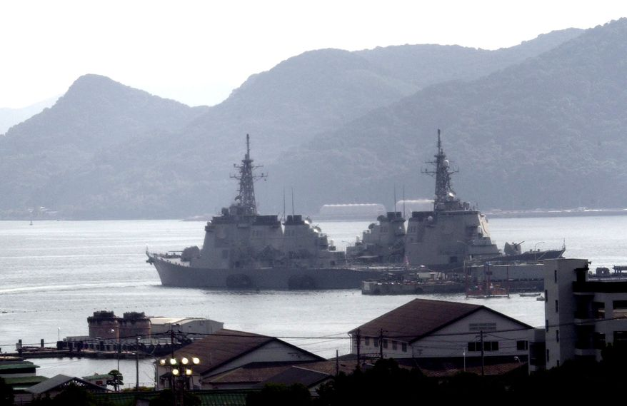 Japanese vessels are shown anchored at Sasebo Naval Base in Nagasaki, Japan. (Associated Press)