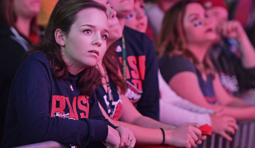 Cleveland Indians Fan Nicole Shriver, left, reacts during a watch party for Game 6 of the baseball World Series between the Indians and the Chicago Cubs, outside Progressive Field, Tuesday, Nov. 1, 2016, in Cleveland. The Cubs won 9-3 to send the series to Game 7, (AP Photo/David Dermer)