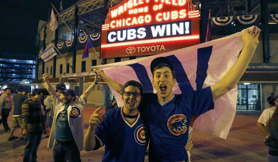Chicago Cubs fans celebrate outside Wrigley Field in Chicago after the Cubs' 9-3 win over the Cleveland Indians in Game 6 of the baseball World Series in Cleveland, Tuesday, Nov. 1, 2016. The Cubs are scheduled to face the Indians in the decisive Game 7 Wednesday. (AP Photo/Charles Rex Arbogast)