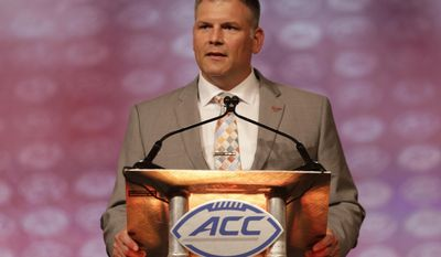 """FILE - In this July 21, 2016, file photo, Virginia Tech head coach Justin Fuente speaks during a news conference at the Atlantic Coast Conference Football Kickoff in Charlotte, N.C. Coaches view distractions the same as injuries _ the fewer the better. That's why Atlantic Coast Conference coaches are cautious about doing an all-access television show such as Showtime's """"A Season With. """"I would at least want to hear them paint the picture of what it was really going to be like before I said yes or no,"""" Virginia Tech coach Justin Fuente said. (AP Photo/Chuck Burton, File)"""