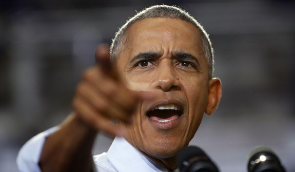 President Barack Obama points to members of the audience while speaking at Capital University Field House in Columbus, Ohio, Tuesday, Nov. 1, 2016.  Obama is kicking off a week of campaigning for Democratic presidential candidate Hillary Clinton with a stop in battleground Ohio. (AP Photo/Pablo Martinez Monsivais)