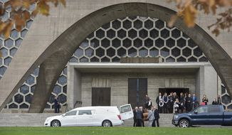 Family members gather on the steps of the St. John's Abbey church as pallbearers place the casket of musician Bobby Vee into a hearse Wednesday, Nov. 2, 2016, following funeral services in Collegeville, Minn. Vee died Monday of advanced Alzheimer's disease at age 73. (Dave Schwarz/St. Cloud Times via AP)