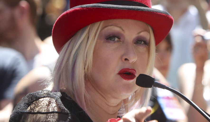 In this June 24, 2012, file photo, entertainer Cyndi Lauper speaks to reporters while serving as grand marshal of the New York City Pride March in New York. (AP Photo/Seth Wenig, File)