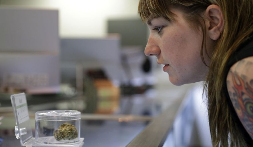 In this, Oct. 27, 2016, photo, Rachael Torricelli looks at marijuana for sale at Blum in Las Vegas. Las Vegas could soon add recreational marijuana to its list of vices if Nevada approves a Nov. 8 referendum on cannabis. Supporters see pot as a fitting alternative for tourists tired of $15 cocktails and hangovers. But weed proponents will have to win over closely divided voters and a risk-averse gambling industry. (AP Photo/John Locher)
