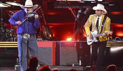 "CORRECTS SONG TITLE AND ID TO CHARLIE DANIELS - Charlie Daniels, left, and Brad Paisley perform "" The Devil Went Down To Georgia"" at the 50th annual CMA Awards at the Bridgestone Arena on Wednesday, Nov. 2, 2016, in Nashville, Tenn. (Photo by Charles Sykes/Invision/AP)"