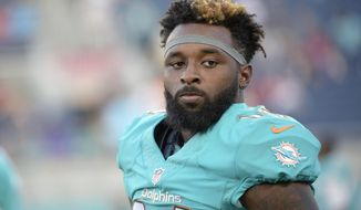 FILE - In this Aug. 25, 2016, file photo, Miami Dolphins wide receiver Jarvis Landry (14) warms up before an NFL preseason football game against the Atlanta Falcons in Orlando, Fla. Two people familiar with the situation said Landry has been fined $24,309 for an illegal crackback block that injured Buffalo Bills safety Aaron Williams. The people confirmed the fine to The Associated Press on condition of anonymity Thursday, Oct. 27, because the NFL had not yet announced the fine. (AP Photo/Phelan M. Ebenhack, File)