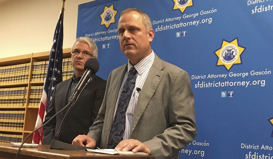 In this photo taken Tuesday, Nov. 1, 2016, San Francisco District Attorney George Gascon, left, and elections director John Arntz, right, discuss election security during a news conference in San Francisco. Officials throughout California are sending the message that despite talk of dirty politics, the state has a clean elections process with few instances of confirmed voter fraud. (AP Photo/Janie Har)