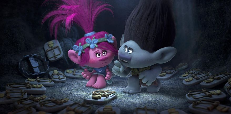 """This image released by Dreamworks Animation shows characters Poppy, left, voiced by Anna Kendrick, and Branch, voiced by Justin Timberlake in a scene from """"Trolls."""" (DreamWorks Animation via AP)"""
