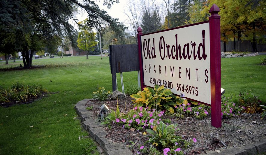 This Tuesday, Nov. 1, 2016 photo shows the front of the Old Orchard Apartments in Holt, Mich.   Authorities say a 6-year-old girl is dead and a person is in custody after a suspected arson at a Lansing-area apartment building. The Delhi Township Fire Department and the Ingham County sheriff's department say the girl's body was found after putting out the fire, which started Tuesday. In a statement, authorities say the fire is being investigated as arson and homicide.   (Dave Wasinger/Lansing State Journal via AP)