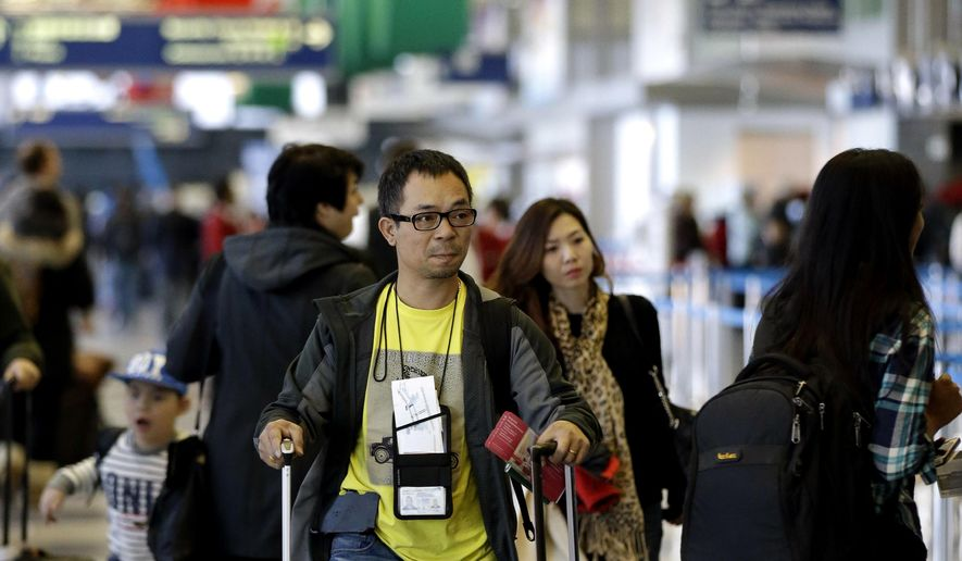 FILE - In this Nov. 25, 2015 file photo, passengers walk in Terminal 3 at O'Hare International Airport in Chicago.   An airline trade group said Wednesday, Nov. 2, 2016 that about 27.3 million people will fly on U.S. airlines over a 12-day period that starts Nov. 18 and ends the Tuesday after Thanksgiving. That's up 2.5 percent from last year.  (AP Photo/Nam Y. Huh)