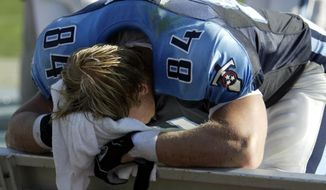 FILE - In this Oct. 3, 2004, file photo, Tennessee Titans' Shad Meier covers his face on the bench in the closing minutes of the Titans 38-17 loss to the San Diego Chargers, in San Diego. The Titans finally ended one skid to the Chargers the last time these teams met in 2013. Now the Titans head to San Diego on Sunday trying to end a losing streak in a place this franchise has lost six straight with the last win all the way back in 1990. (AP Photo/Lenny Ignelzi, File)