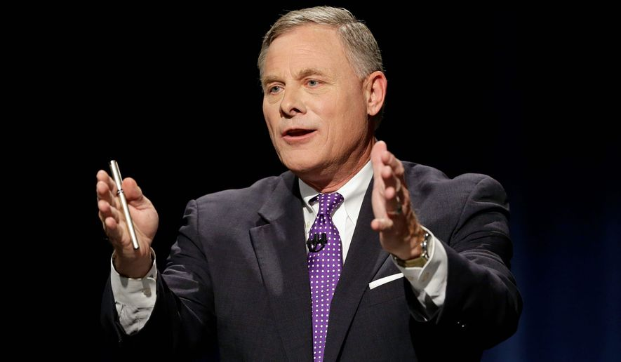 Sen. Richard Burr, North Carolina Republican, was caught on tape privately joking about gun owners taking aim at Hillary Clinton. (Associated Press)