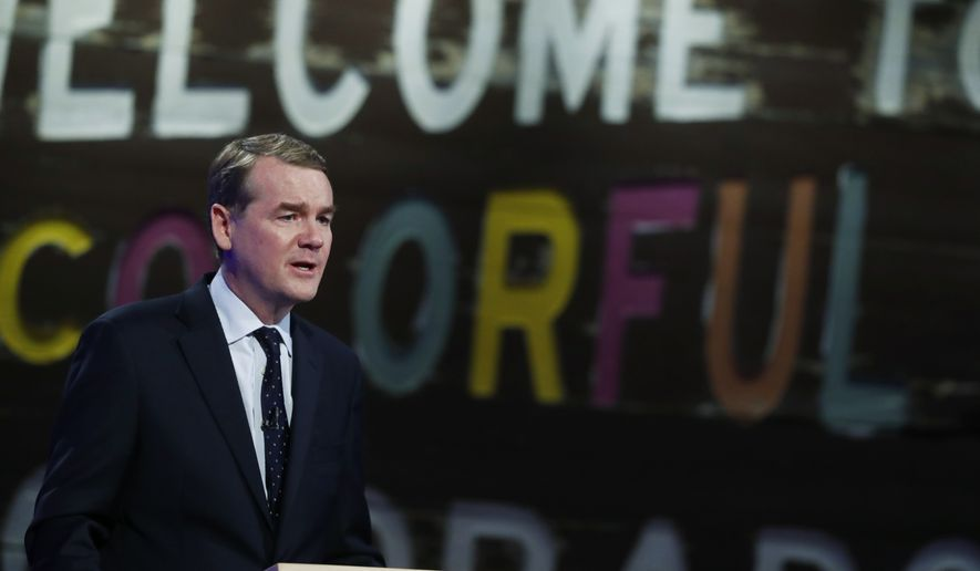 U.S. Sen. Michael Bennet, D-Colo., makes a point while facing Republican U.S. Senate candidate Darryl Glenn in a televised debate at History Colorado, Tuesday, Oct. 11, 2016, in Denver. (AP Photo/David Zalubowski)
