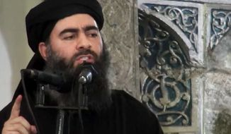 """Holding your ground with honor is a thousand times easier than retreating in shame,"" Islamic State leader Abu Bakr al-Baghdadi told fighters in an audio recording, according to Agence France-Presse. (Associated Press)"