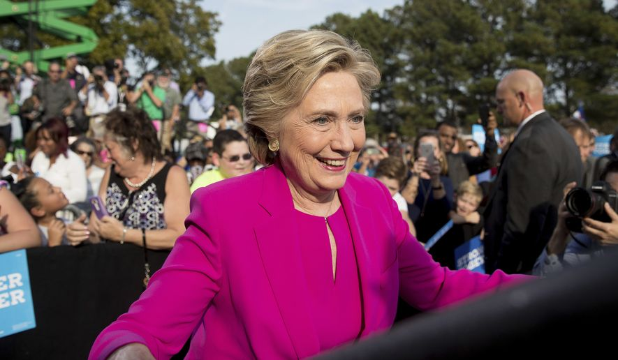 Democratic presidential candidate Hillary Clinton arrives to speak at a campaign rally at Pitt Community College in Winterville, N.C., Thursday, Nov. 3, 2016. (AP Photo/Andrew Harnik)