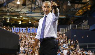 President Barack Obama arrives at a rally for Democratic presidential nominee Hillary Clinton at Florida International University Arena on Thursday, Nov. 3, 2016. (Al Diaz/Miami Herald via AP)