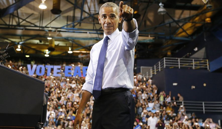President Barack Obama arrives at a rally for Democratic presidential nominee Hillary Clinton at Florida International University Arena on Thursday, Nov. 3, 2016. (Al Diaz/Miami Herald via AP)