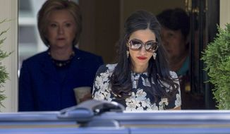 Huma Abedin is just one of Hillary Clinton's top aides still swept up in the furor over the former secretary of state's use of a private email server. (Associated Press/File)