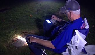 Wayne Williams drove from North Carolina to a cemetery in Greenwood, Indiana, to honor a pact he made with his late father. Mr. Williams listened to the Chicago Cubs in the team's first World Series title in 108 years. (WTHR-13 NBC Indiana screenshot)