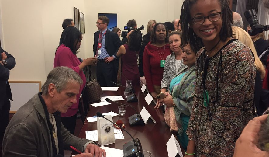 "Kendall Clark, a sophomore at the Park School of Baltimore, gets an autograph from Oscar-winning actor Jeremy Irons at a White House panel on STEM (science, technology, engineering, mathematics) studies on Oct. 28. Kendall is one of the first students selected for the Spirit of Ramanujan Initiative, a global mentoring program for young mathematicians. Mr. Irons stars in a new film about Srinivasa Ramanujan, titled ""The Man Who Knew Infinity."" Photo by Julia Porterfield / The Washington Times"