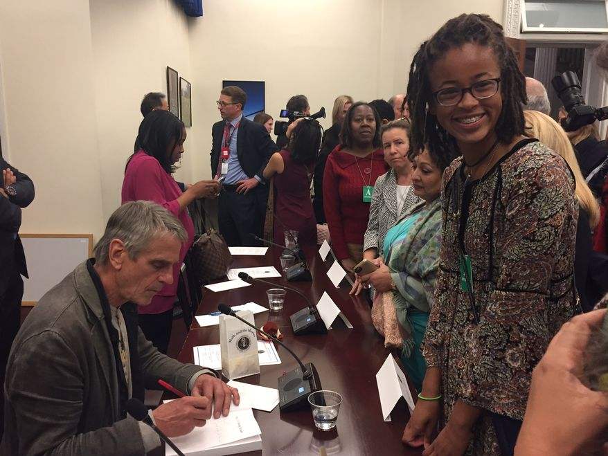 """Kendall Clark, a sophomore at the Park School of Baltimore, gets an autograph from Oscar-winning actor Jeremy Irons at a White House panel on STEM (science, technology, engineering, mathematics) studies on Oct. 28. Kendall is one of the first students selected for the Spirit of Ramanujan Initiative, a global mentoring program for young mathematicians. Mr. Irons stars in a new film about Srinivasa Ramanujan, titled """"The Man Who Knew Infinity."""" Photo by Julia Porterfield / The Washington Times"""