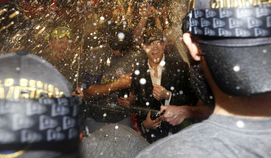 Chicago Cubs president for baseball operations Theo Epstein celebrates with the team after Game 7 of the Major League Baseball World Series Thursday, Nov. 3, 2016, in Cleveland. The Cubs won 8-7 in 10 innings to win the series 4-3. (AP Photo/David J. Phillip)