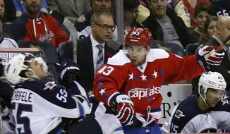 Winnipeg Jets center Mark Scheifele (55) is checked by Washington Capitals right wing Tom Wilson (43) in the second period of an NHL hockey game, Thursday, Nov. 3, 2016, in Washington. (AP Photo/Alex Brandon)