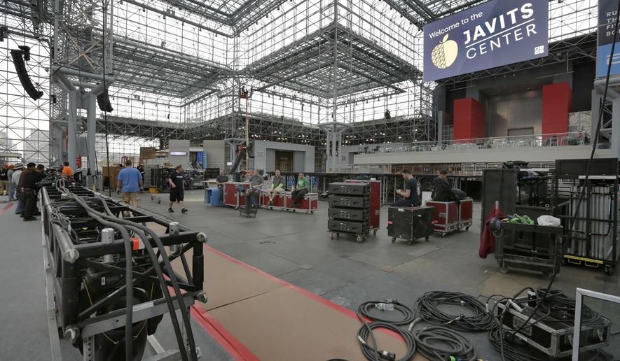 """Workers prepare Democratic presidential candidate Hillary Clinton's election night venue, inside the Jacob K. Javits Convention Center, in New York, Thursday, Nov. 3, 2016. New York City is preparing for an election night like few others in its history, with both candidates planning """"victory"""" parties about a mile apart in midtown Manhattan. (AP Photo/Richard Drew)"""