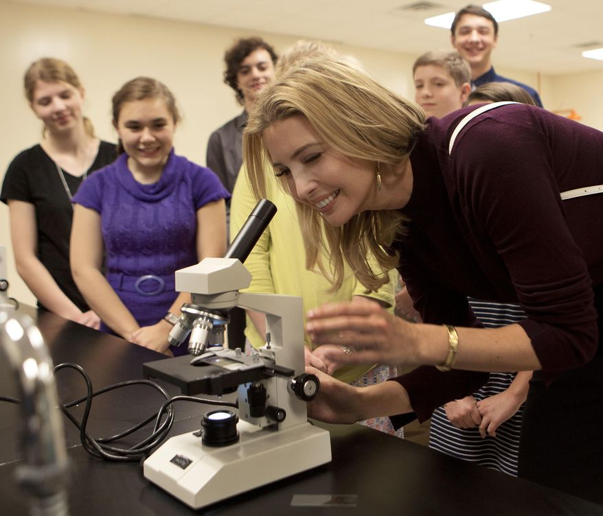 Ivanka Trump looks at an onion slide during a campaign stop for her father, Republican presidential candidate Donald Trump, Thursday, Nov. 3, 2016, at the Founders Academy, a public chartered school in Manchester, N.H. (AP Photo/Jim Cole)