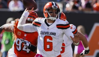 FILE - In this Oct. 23, 2016, file photo, Cleveland Browns quarterback Cody Kessler throws under pressure in the first half of an NFL football game against the Cincinnati Bengals in Cincinnati. Kessler missed a Oct. 30, 2016, 31-28 loss to the New York Jets with a concussion but was cleared this week. (AP Photo/Gary Landers, File)