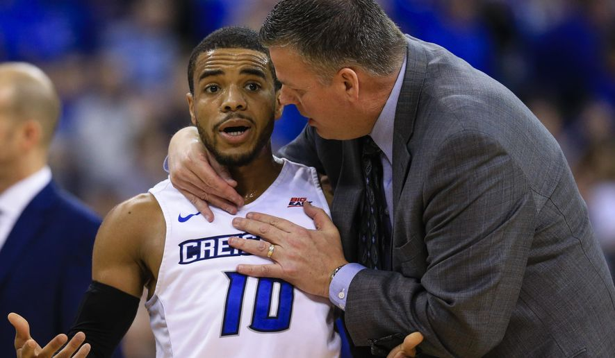 FILE- In this Feb. 9, 2016, file photo, Creighton coach Greg McDermott talks to point guard Maurice Watson Jr. (10) during a time out in the first half of an NCAA college basketball game against Xavier in Omaha, Neb. With one of the best point guards in the country and a strong cast around him, Creighton is poised to continue its climb in the Big East (AP Photo/Nati Harnik, file)