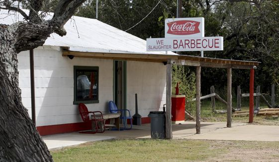 """ADVANCE FOR SUNDAY NOV. 6 - This Oct. 19, 2016 photo shows the gas station where part of the original """"Texas Chainsaw Massacre"""" was filmed in Batrop, Texas.  The exterior has been restored to look as it did in the 1974 film. (Rob Clark/College Station Eagle via AP)"""