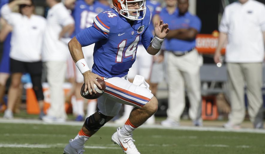 FILE - In this Oct. 29, 2016, file photo, Florida quarterback Luke Del Rio runs for yardage against Georgia during the first half of an NCAA college football game, Saturday, Oct. 29, 2016, in Jacksonville, Fla. No. 10 Florida has the toughest part of its schedule ahead, a daunting November slate that begins Saturday at Arkansas and includes road games against No. 15 LSU and No. 19 Florida State. (AP Photo/John Raoux, File)