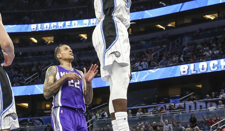Orlando Magic forward Jeff Green (34) dunks the ball in front of Sacramento Kings forward Matt Barnes (22) during the first half of an NBA basketball game, Thursday, Nov. 3, 2016, in Orlando, Fla. (AP Photo/Gary McCullough)