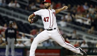 In this photo taken Sept. 6, 2016, Washington Nationals starting pitcher Gio Gonzalez throws during the third inning of a baseball game against the Atlanta Braves at Nationals Park in Washington. The Washington Nationals have exercised their $12 million club option for 2017 on left-hander Gio Gonzalez's contract.  (AP Photo/Alex Brandon)