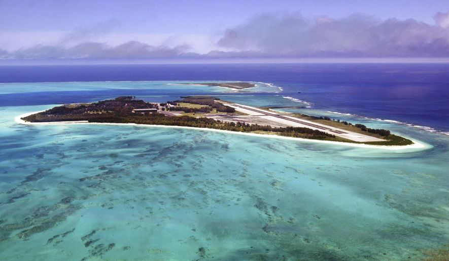 FILE - In this June 5, 2002 file photo, waves crash on the shores of Midway Atoll in the Northwestern Hawaiian Islands. The Battle of Midway was a major turning point in World War II's Pacific theater. But the remote atoll where thousands died is now a delicate sanctuary for millions of seabirds, and a new battle is pitting preservation of its vaunted military history against the protection of its wildlife. (AP Photo/Ronen Zilberman, File)