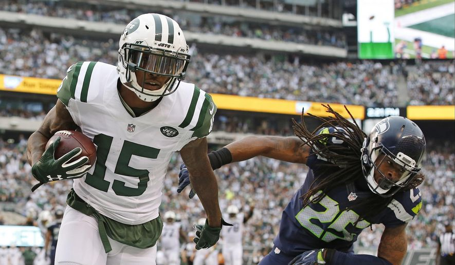 ADVANCE FOR WEEKEND EDITIONS, NOV. 5-6 - FILE - In this Oct. 2, 2016, file photo, New York Jets wide receiver Brandon Marshall (15) scores a touchdown as Seattle Seahawks' Richard Sherman (25) defends during the first half of an NFL football game, in East Rutherford, N.J. Opposing quarterbacks and offensive coordinators no longer are sacrificing the portion of the field patrolled by star cornerbacks. (AP Photo/Kathy Willens, File)