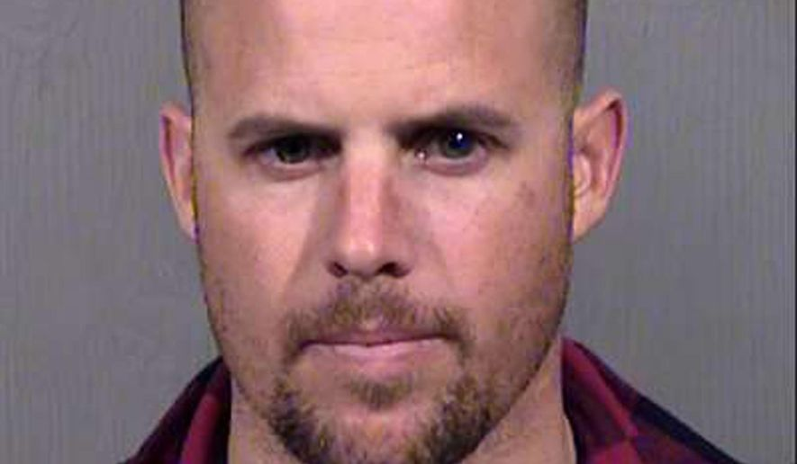 FILE - This Jan. 27, 2016, file photo, provided by the Maricopa County Sheriff's Office shows Jon Ritzheimer, who was arrested in Arizona on Jan. 26, 2016, in connection with the occupation of the Malheur National Wildlife Refuge in Oregon. Ritzheimer, who pleaded guilty to conspiracy as part of a plea bargain, the same charge that a just acquitted seven other occupiers were acquitted of last week, says his lawyer is talking with prosecutors about withdrawing his guilty plea as a possible future option. (Maricopa County Sheriffs Office via AP, file)
