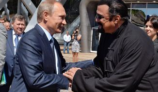 In this Sept. 4, 2015 file photo, Russian President Vladimir Putin, left, and U.S. actor Steven Seagal shake hands after visiting an oceanarium built on Russky Island, in the Russian Far Eastern port of Vladivostok. Putin's spokesman, Dmitry Peskov, told reporters on Thursday, Nov. 3, 2016, that Russia has awarded Russian citizenship to Seagal. (AP Photo/Alexei Druzhinin/Sputnik, Government Press Service Pool Photo via AP, File)