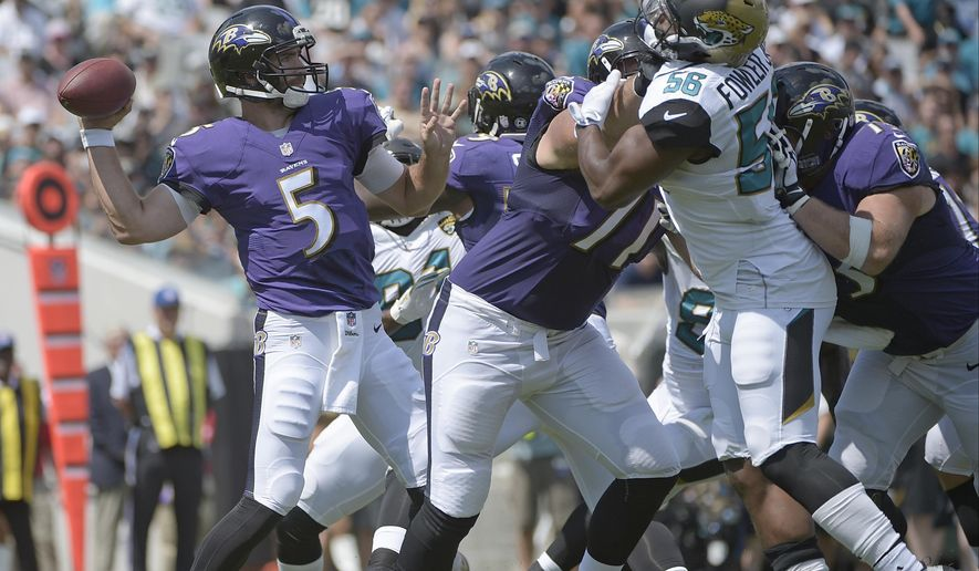 FILE - In this Sept. 25, 2016, file photo, Baltimore Ravens quarterback Joe Flacco (5) throws a pass as he is pressured by Jacksonville Jaguars defensive end Dante Fowler (56) during the first half of an NFL football game in Jacksonville, Fla. On Sunday, first place in the AFC North will be at stake when Pittsburgh comes to Baltimore. The Ravens will finally have a full offensive line after left tackle Ronnie Stanley (foot) and right guard Marshal Yanda healed during the bye week. That should enable Flacco to have more time in the pocket, and it might open up the running game, too. (AP Photo/Phelan M. Ebenhack)