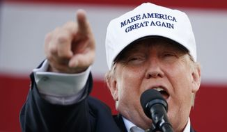 In this Wednesday, Nov. 2, 2016, file photo, Republican presidential candidate Donald Trump speaks during a campaign rally in Miami. (AP Photo/ Evan Vucci, file)