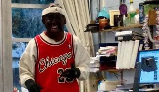 Ingraham High School teacher Peter Colino was put on administrative leave after wearing a black Michael Jordan mask and black gloves during class on Halloween. (Snapchat via The Stranger)