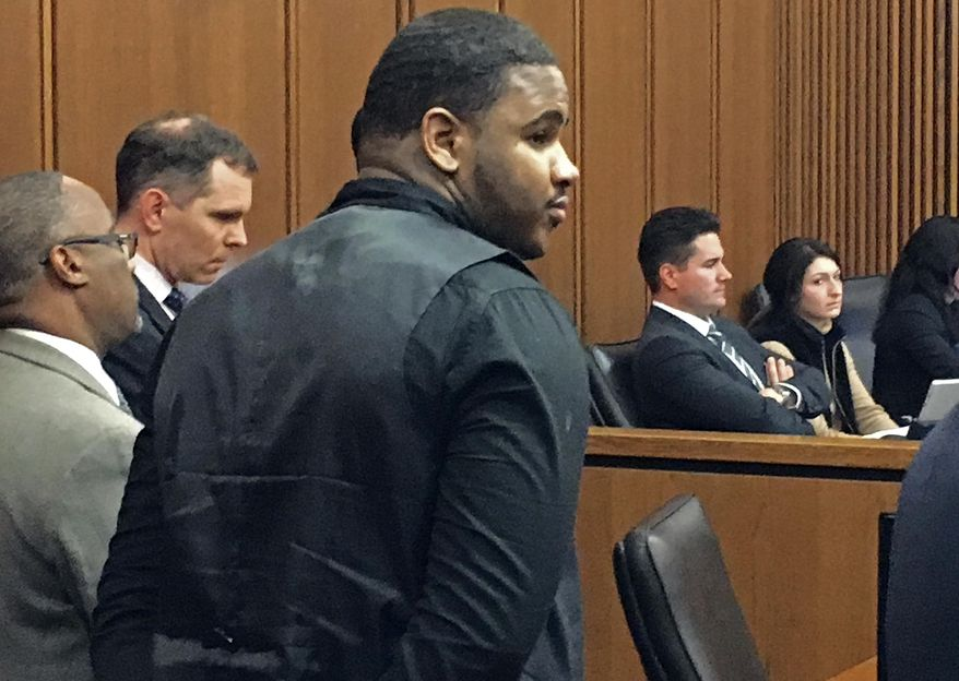 Douglas Shine Jr., front center, stands with attorneys as a verdict is read in his trial Friday, Nov. 4, 2016, at the Cuyahoga County Justice Center in Cleveland. Shine, accused of killing three people at a barbershop outside Cleveland, was found guilty on Friday of aggravated murder and other charges and could face the death penalty. (AP Photo/Mark Gillispie)