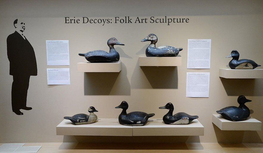 "In this Oct. 27, 2016 photo, duck decoys carved by Erie native Frank Buchner are shown at the Erie Art Museum in Erie, Pa. The decoys are part of an exhibit, titled, ""Erie Decoys: Folk Art Sculpture,"" featuring many decoys carved in Erie during the first half of the 20th century. (Jack Hanrahan/Erie Times-News via AP)"