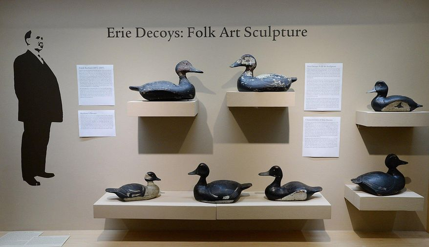 """In this Oct. 27, 2016 photo, duck decoys carved by Erie native Frank Buchner are shown at the Erie Art Museum in Erie, Pa. The decoys are part of an exhibit, titled, """"Erie Decoys: Folk Art Sculpture,"""" featuring many decoys carved in Erie during the first half of the 20th century. (Jack Hanrahan/Erie Times-News via AP)"""