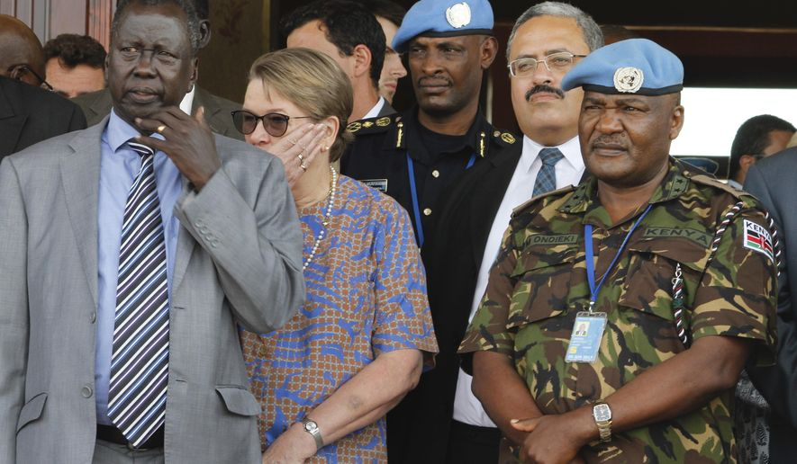In this photo taken Friday, Sept. 2, 2016, United Nations Mission in South Sudan (UNMISS) force commander Lt. Gen. Johnson Mogoa Kimani Ondieki of Kenya, right, stands next to Ellen Loj, center, Special Representative of the UN Secretary-General, and an unidentified member of South Sudan's government, left, as they await a delegation of U.N. Security Council members, in Juba, South Sudan. Kenya's foreign affairs ministry said Wednesday, Nov. 2, 2016 that it is pulling out its 1,000 troops deployed to South Sudan as part of the U.N. peacekeeping mission after the U.N. secretary-general fired the force's Kenyan commander. (AP Photo/Justin Lynch)