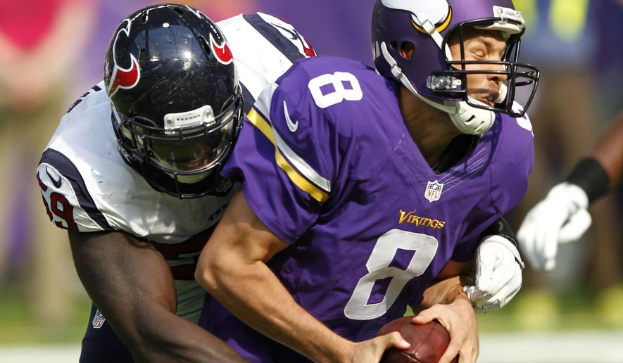 FILE - In this Oct. 9, 2016, file photo, Minnesota Vikings quarterback Sam Bradford (8) is sacked by Houston Texans outside linebacker Whitney Mercilus, left, during the first half of an NFL football game in Minneapolis. The Vikings are getting desperate to better protect Bradford. (AP Photo/Andy Clayton-King, File)